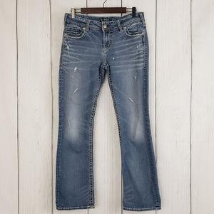 Silver Suki Distressed Slim Boot Jeans